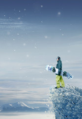 Snowboarder standing and looking forward