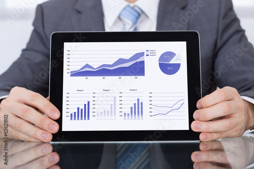 Businessperson Showing Graph