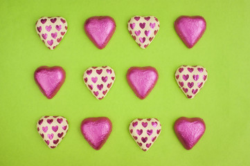 Collection of chocolate heart shapes wrapped in tin foil.