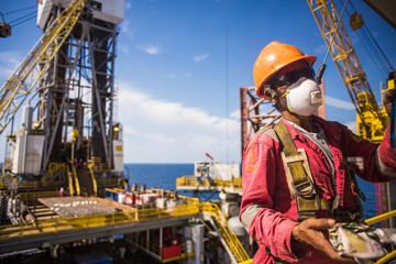 Man working at height with full PPE in oil rig in Thailand