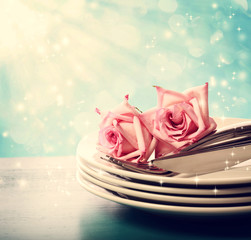 Dinner plates with pink roses