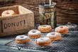 Icing sugar falling on fresh donuts