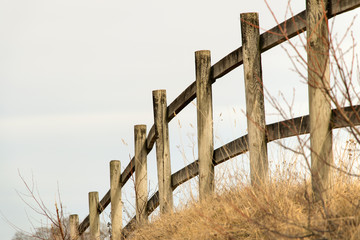 wooden fence in rural landscape
