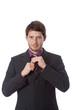 Successful man correcting tie