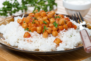 white rice with chickpeas in tomato sauce, close-up