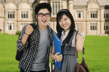 Attractive students expressing success outdoor