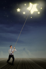 Businessman pulling stars