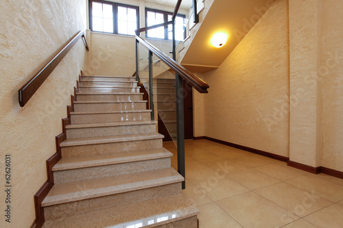 Modern stone stairs with wooden banister