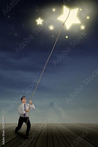 Businessman pulling stars