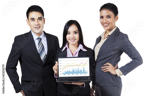 Businesspeople showing profit chart