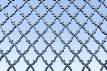 pattern of the fence grill against blue sky