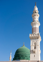 Towers of the Nabawi mosque againts blue sky