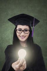 Female student giving bright light bulb