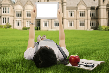 Female student using a digital tablet outdoor