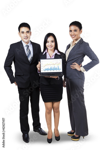 Group of businesspeople showing business chart