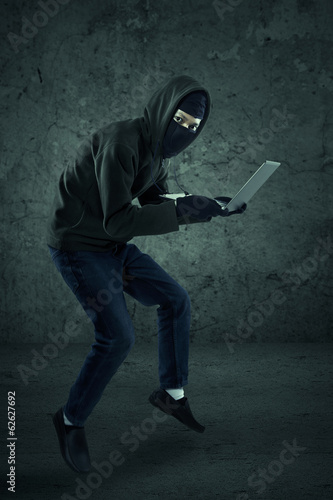 Hacker is stealing a notebook