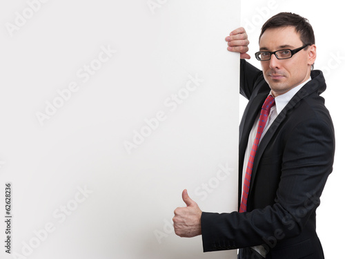 Happy business man showing blank signboard
