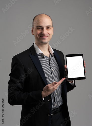 Business man shows tablet computer with blank screen