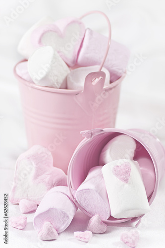 White and pink marsmallow in buckets