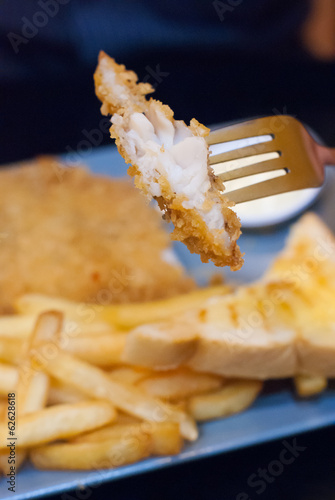 Fried fish with chunky chips.