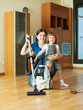 mother and child  with vacuum cleaner