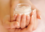 Fototapety Beautiful woman hands with cream