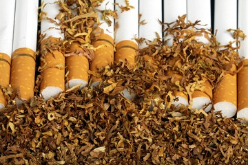 tobacco and cigarettes on the black background
