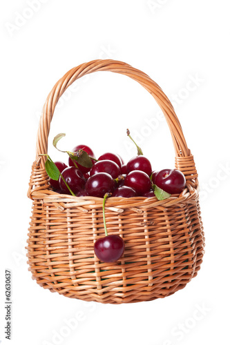 Ripe cherries in a wattled baske