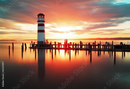 Beach sunrise with lighthouse