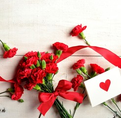 Red carnation with message card