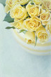 Vase with a bouquet of yellow spring roses