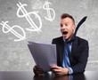 surprised businessman reading shocking good results