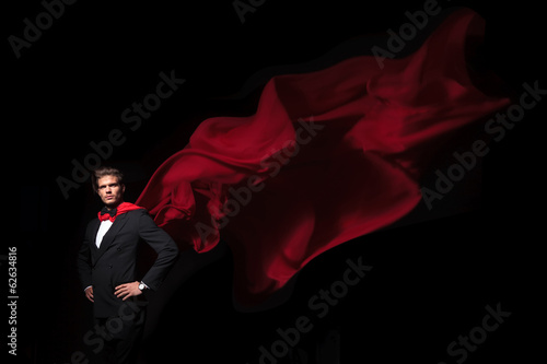super hero business man in red cape