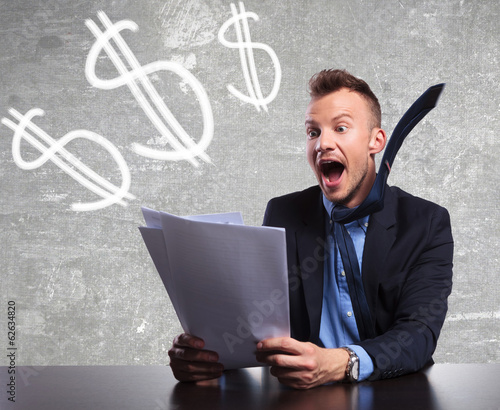 surprised businessman reading shocking good results