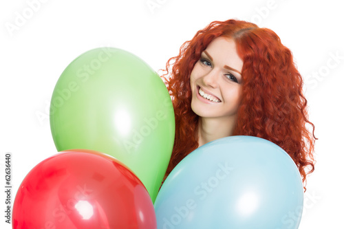 Portrait young girl holding colorful balloons.