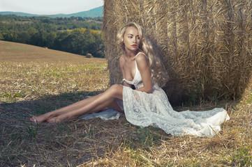 Sexy blonde in hayfield