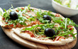 Pizza Margherita with Fresh Arugula Leaves and Olives