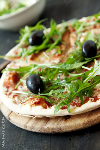 Closeup of Pizza Margherita with Arugula and Olives
