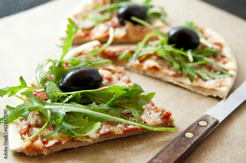 Slice of Pizza Margherita with Arugula and Olives