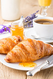 Fototapety Croissants with orange jam and coffee. Shallow depth of field.