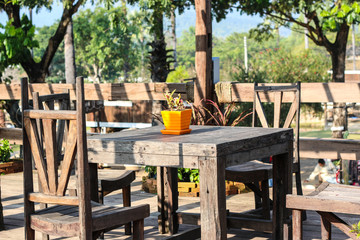 old wooden table and chairs outdoors