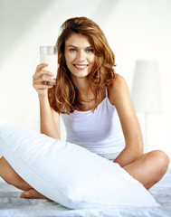 Glass of milk in bed