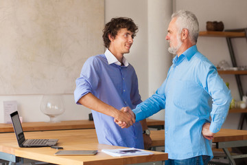 Portrait of  business entrepreneur shaking hands with colleague