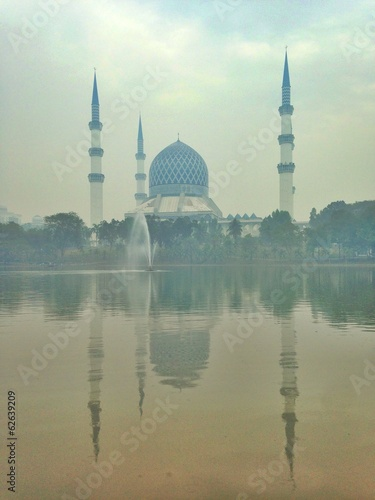 a blue mosque by the lake