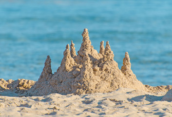 Sand castle on the beach.
