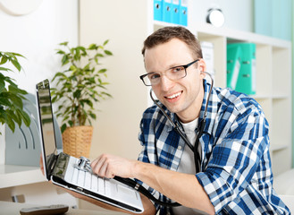 young man repairing a computer office
