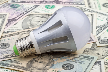 LED electric bulb on dollar