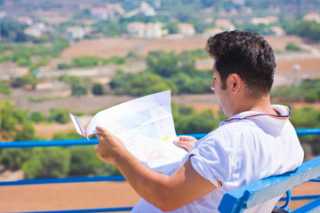 Man sits and holding map