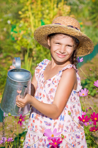 girl posing with metal watering can
