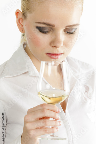 portrait of young woman tasting white wine